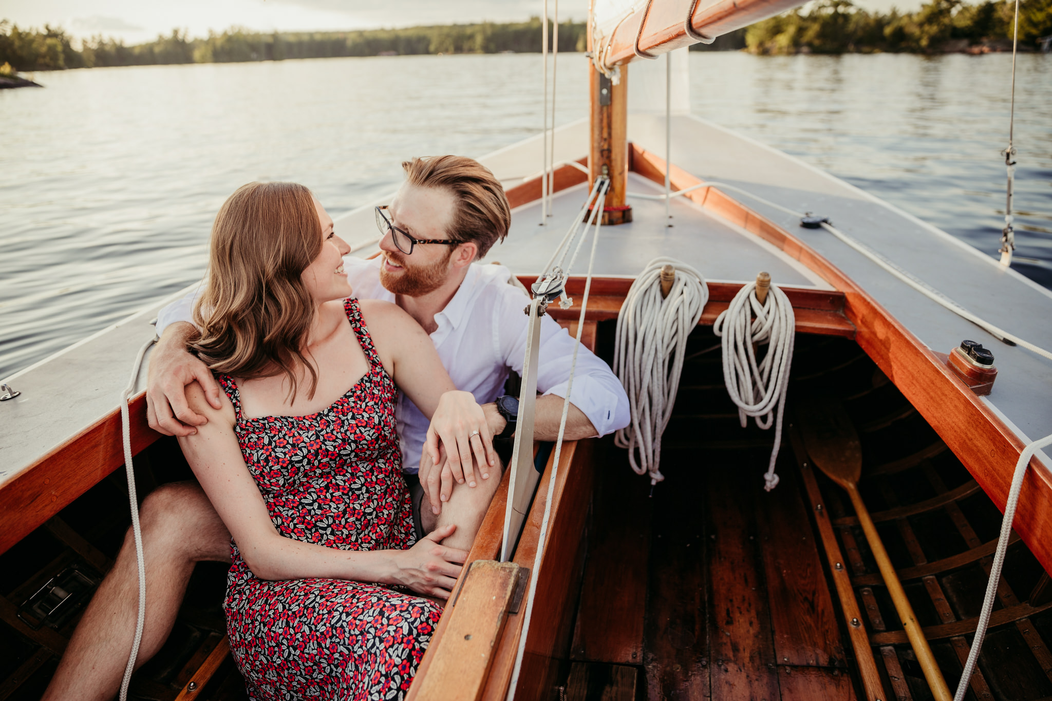 couple sitting in a sailboat on Stony Lake in Lakefield