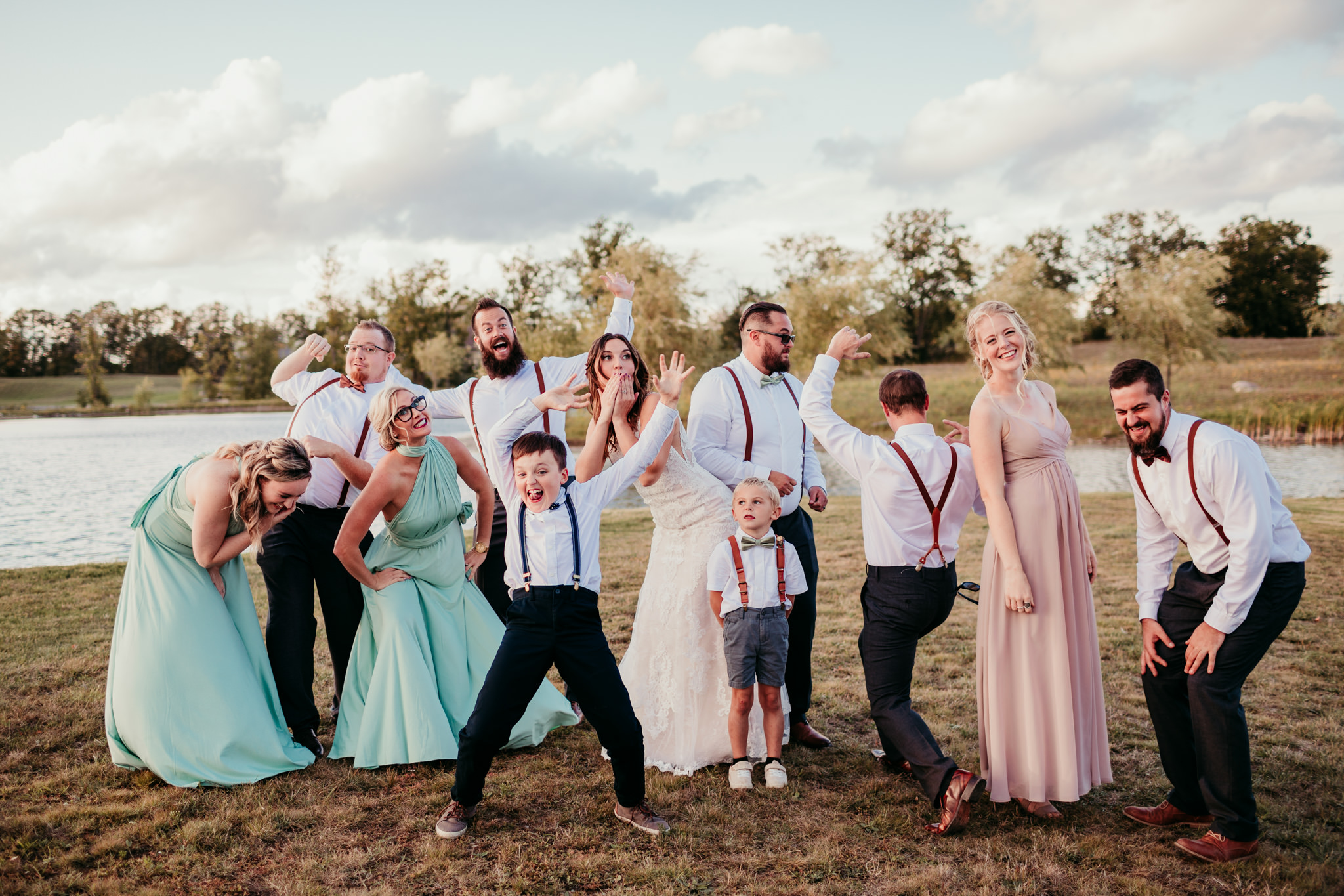 wedding party at sunset being silly for the camera