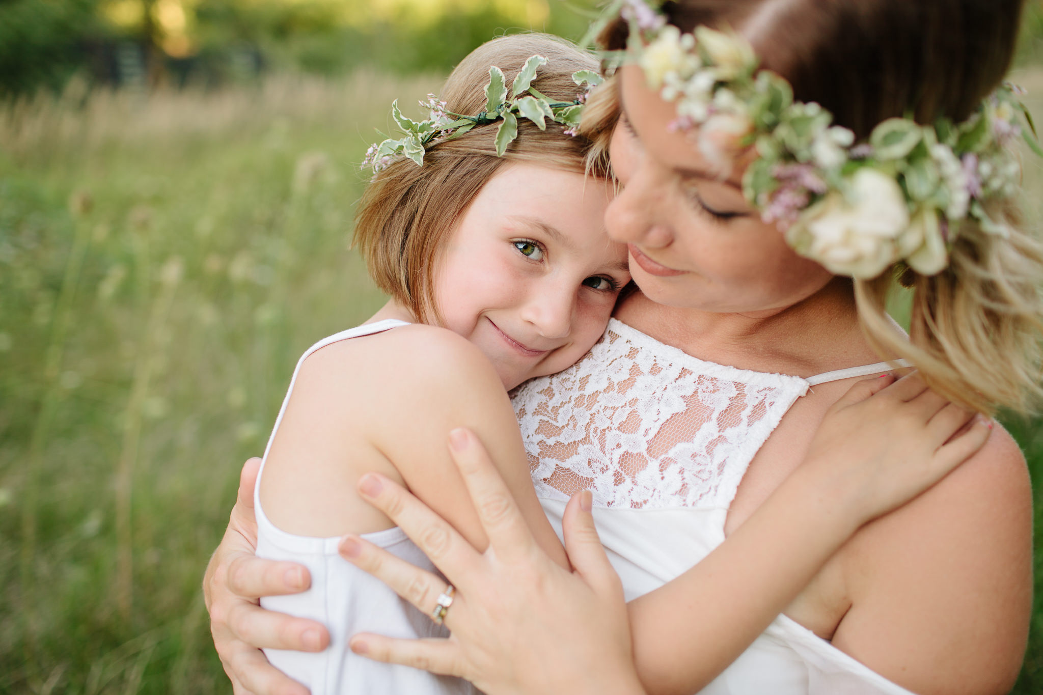 mother and daughter outdoor hug for portrait