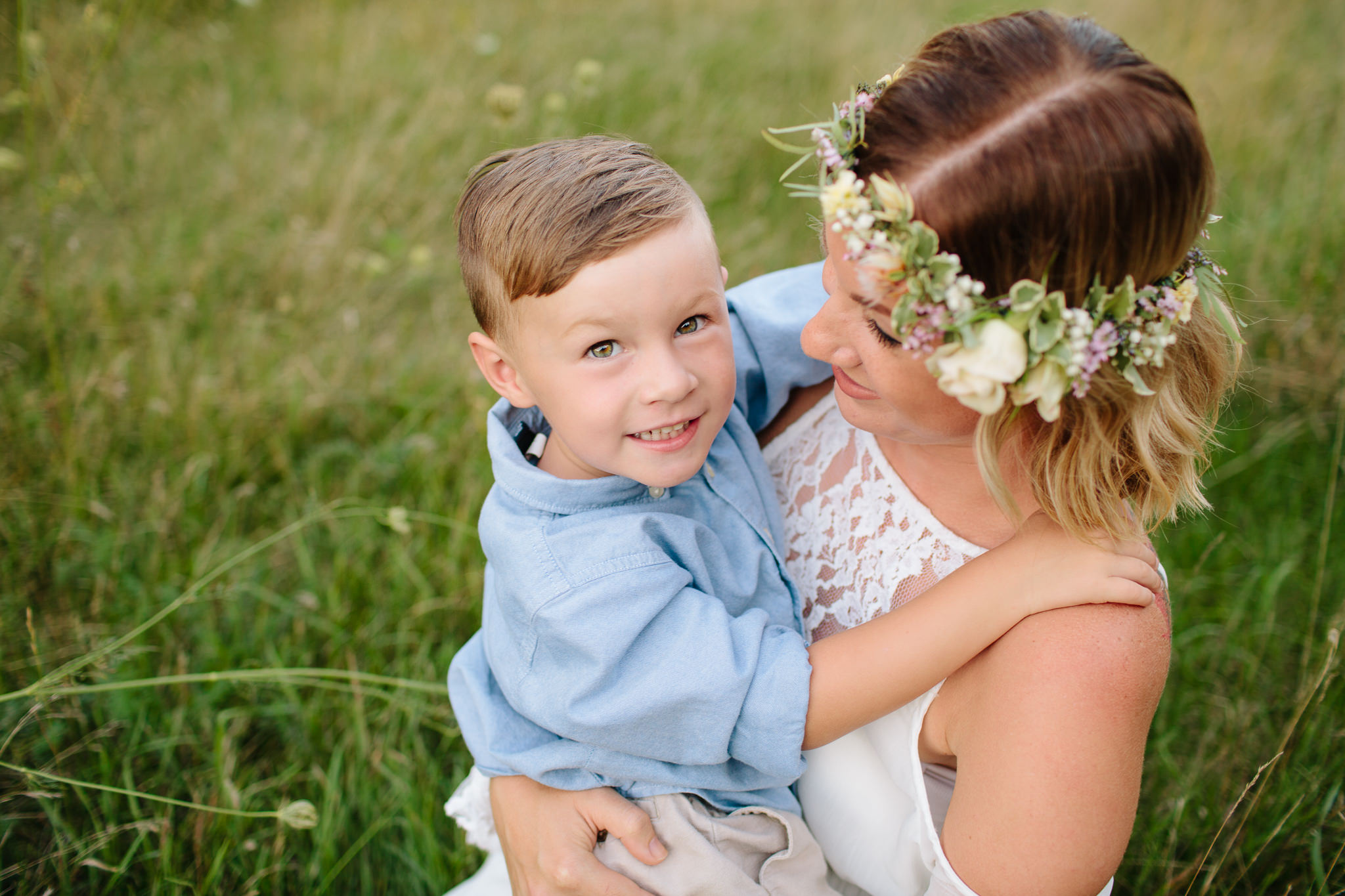 mother and son smiling for outdoor portrait