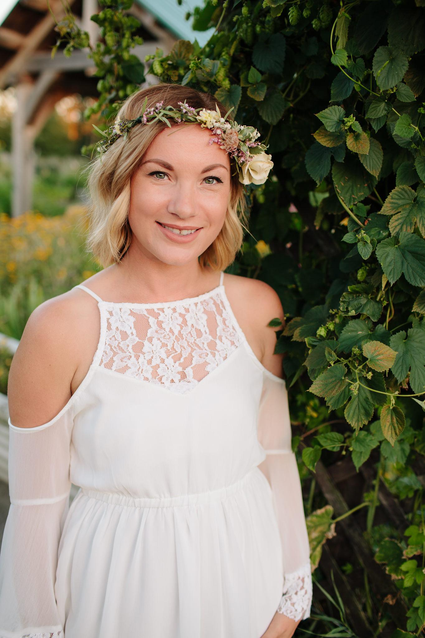 girl smiling wearing floral crown