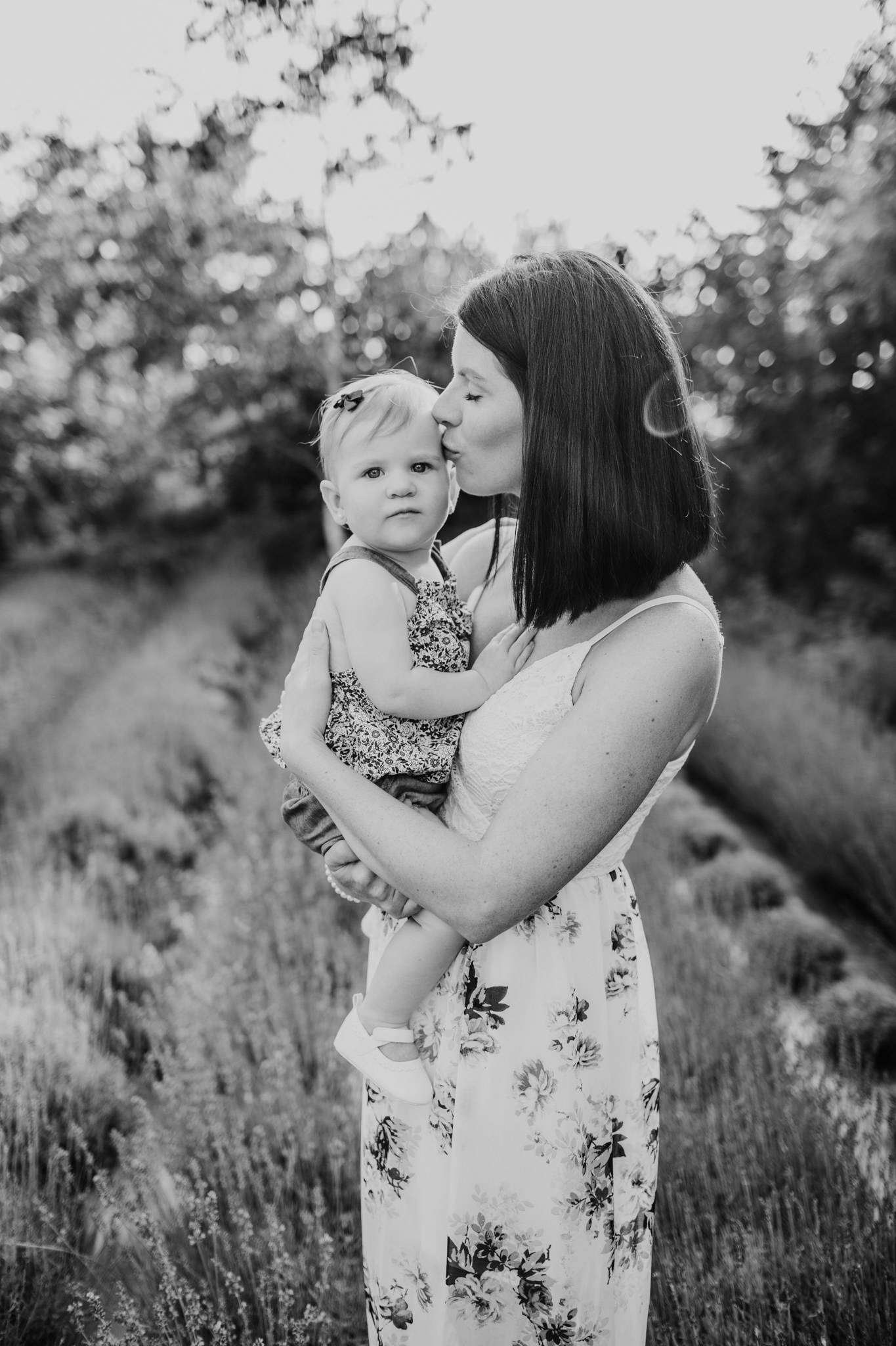 mother and daughter snuggling in the sunset in a lavender field black and white image