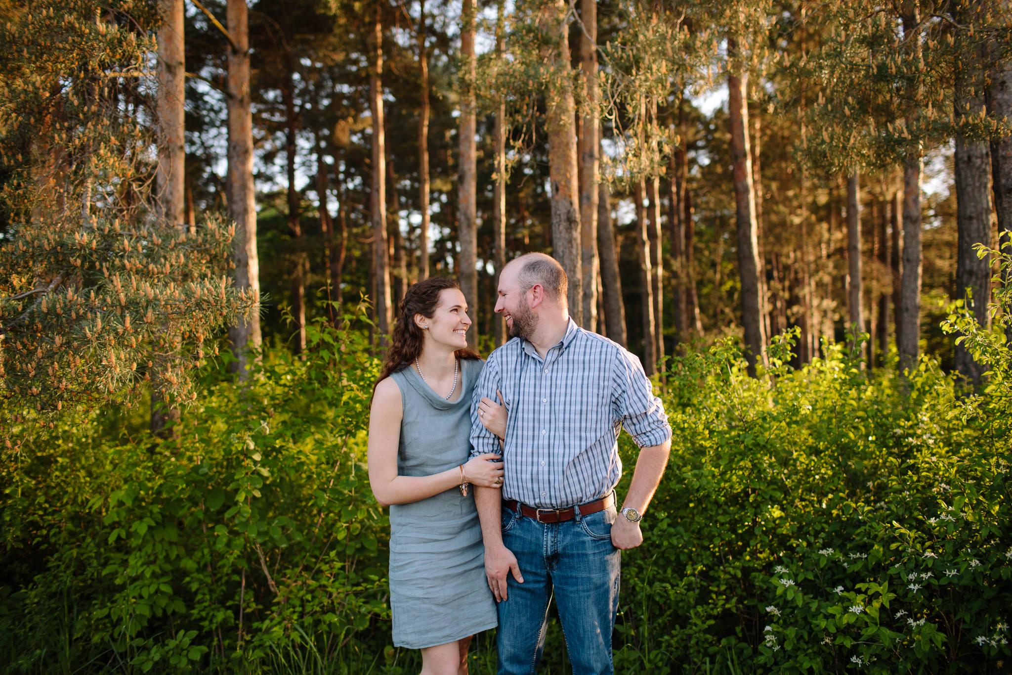 couple embracing infront of trees for engagement photo