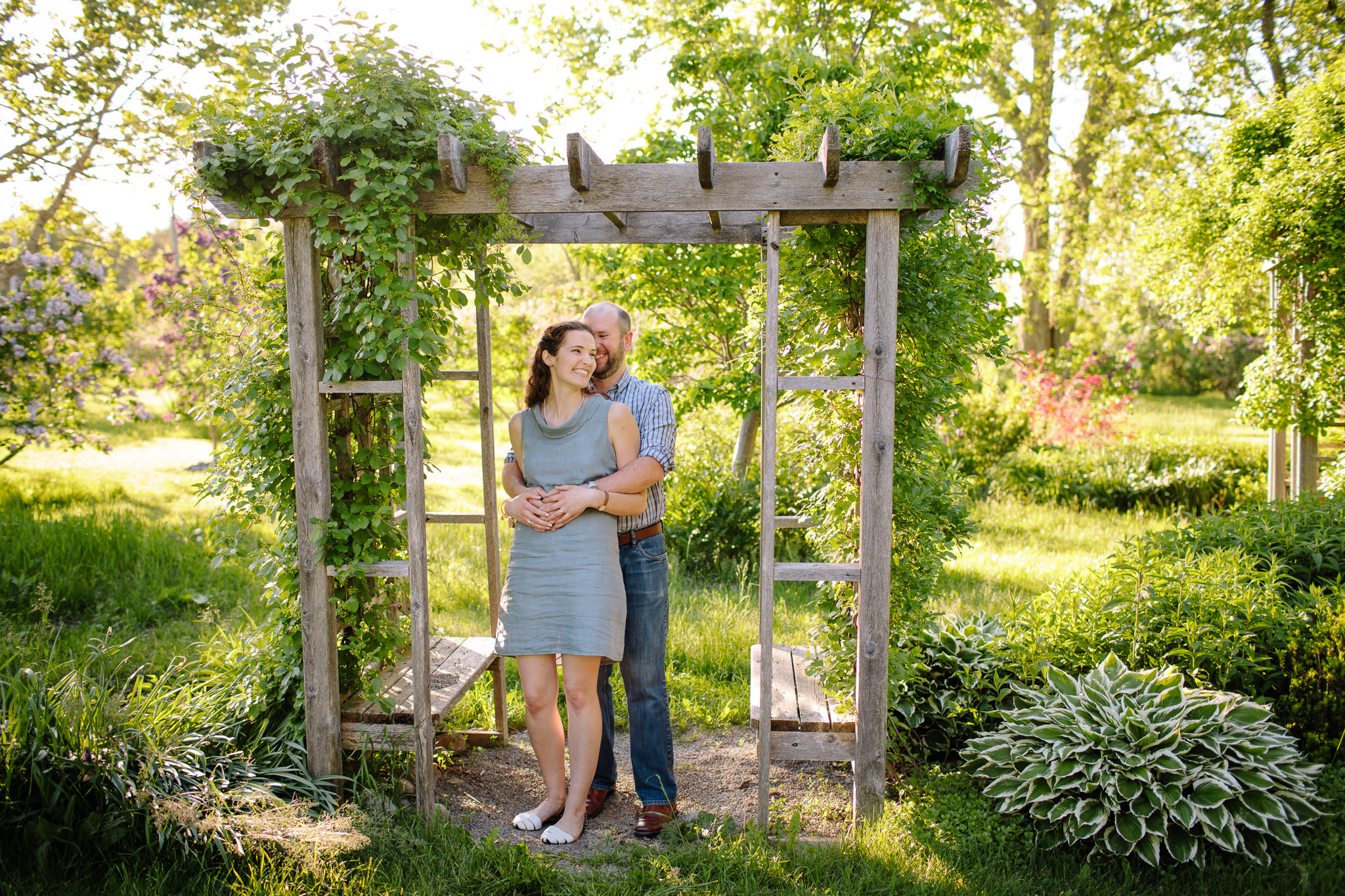 engaged couple holding each other in garden