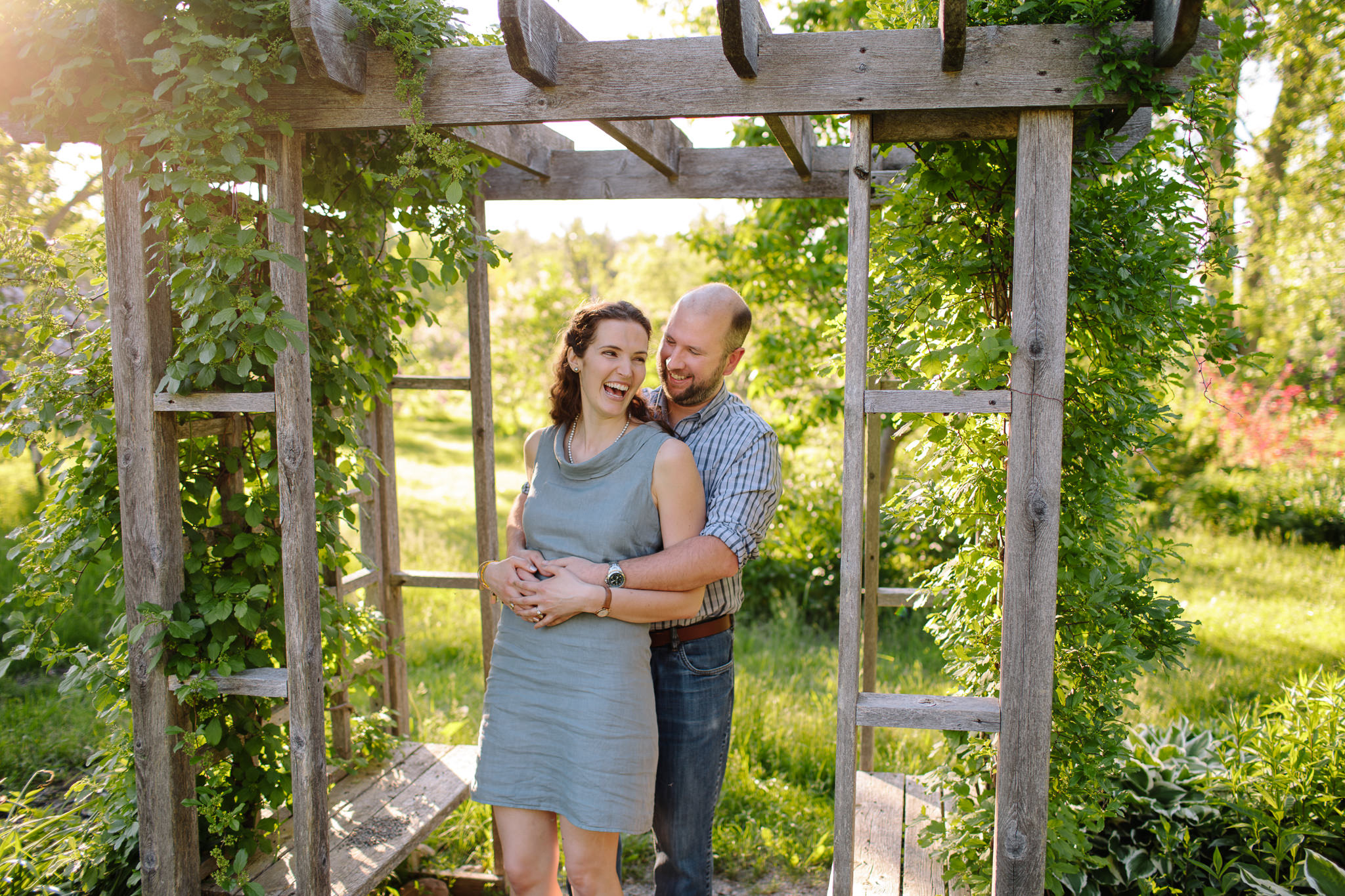 engaged couple laughing in lilac garden in lindsay
