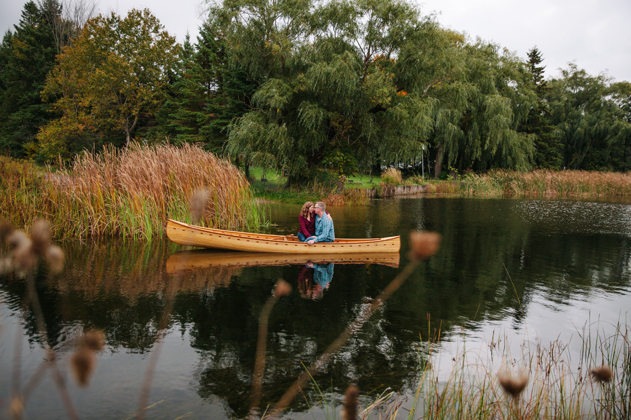 engaged couple in bobcaygeon in canoe