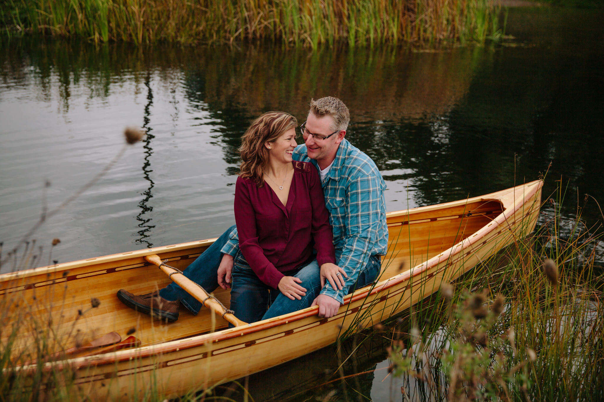 engaged couple laughing in bobcaygeon