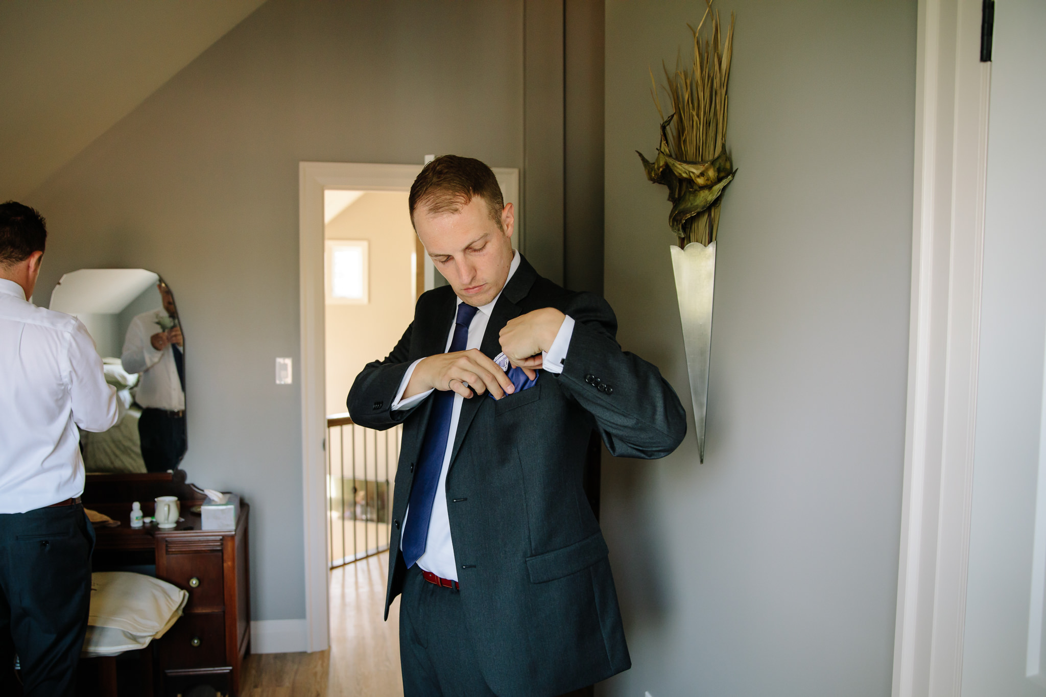 groom putting in pocket square