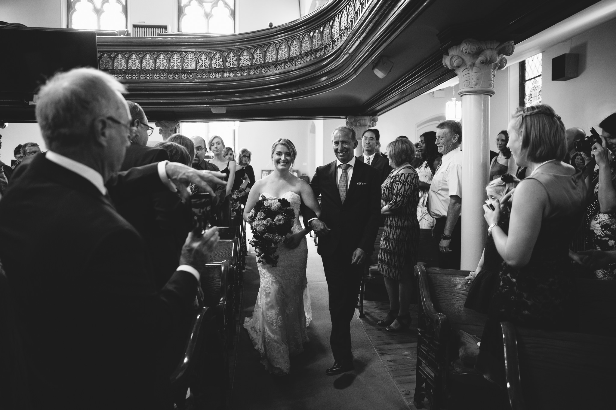 bride and father walking down aisle at st. andrews church