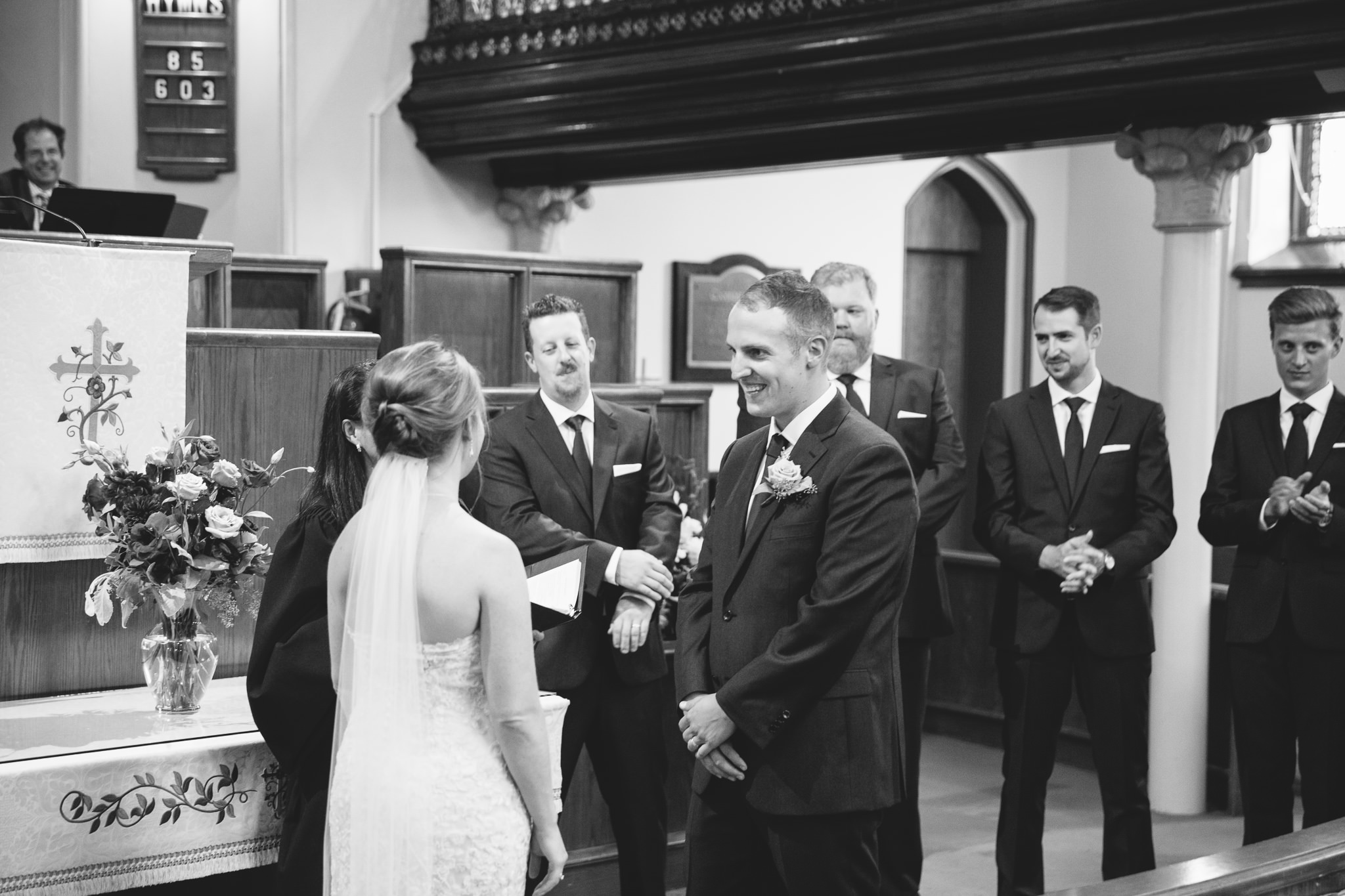groom smiling at bride in St. Andrews Church in Lindsay, ON