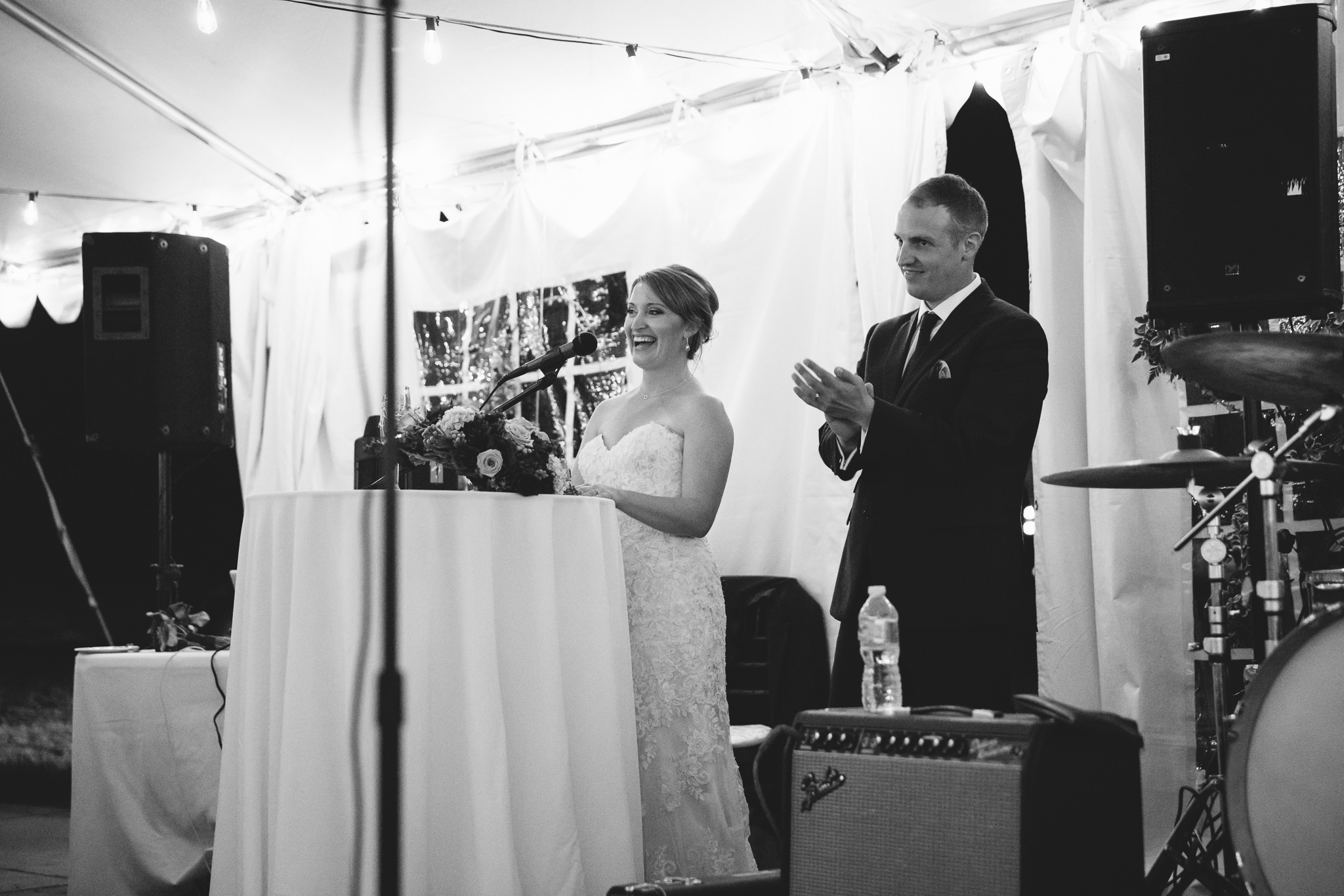 bride and groom give speech