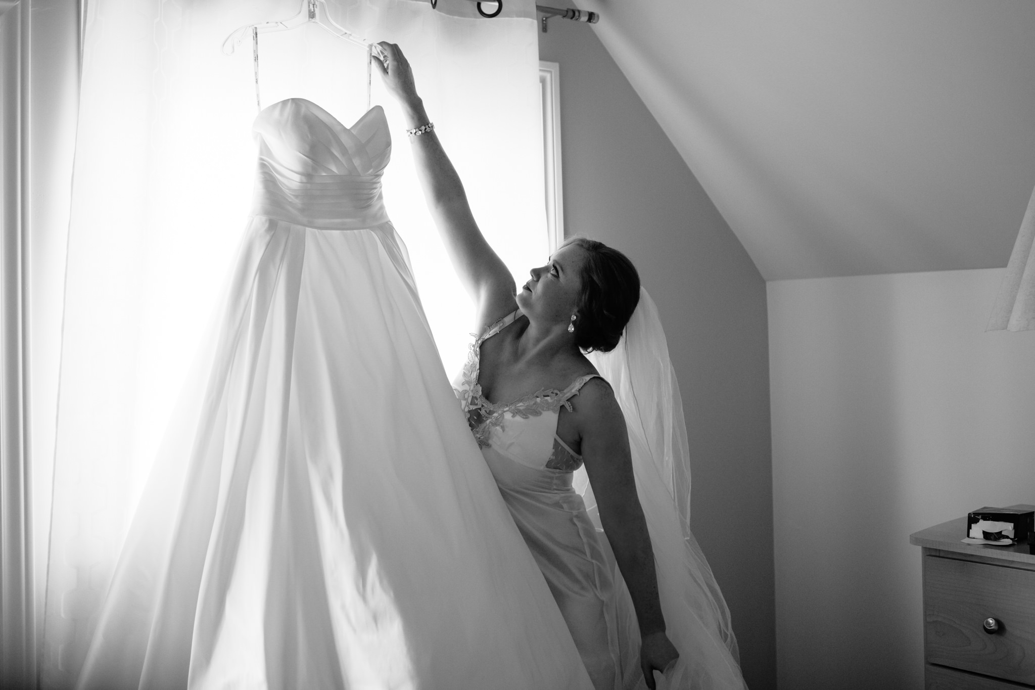 bride getting down wedding dress to put on