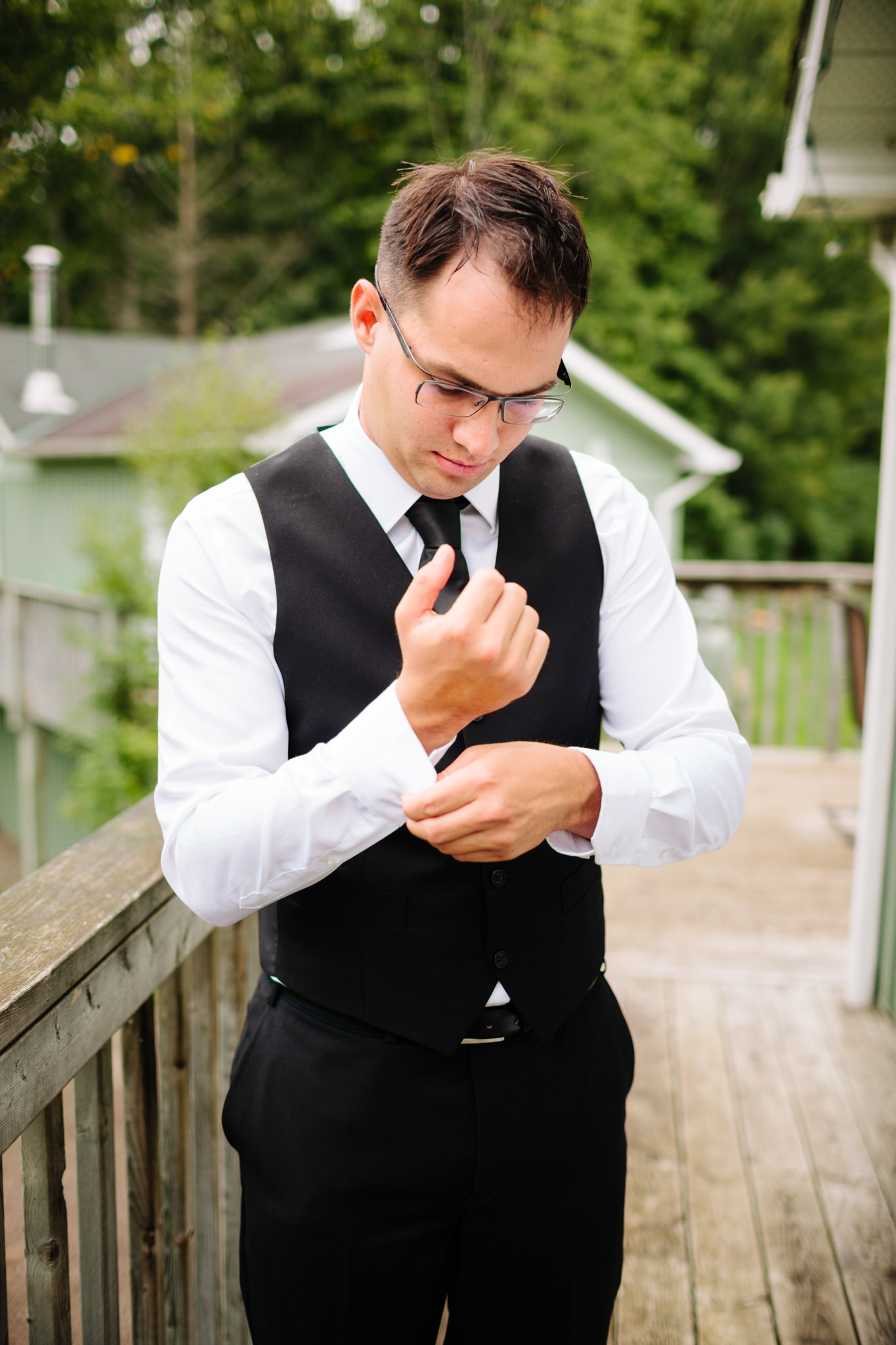 groom fixing cuff links