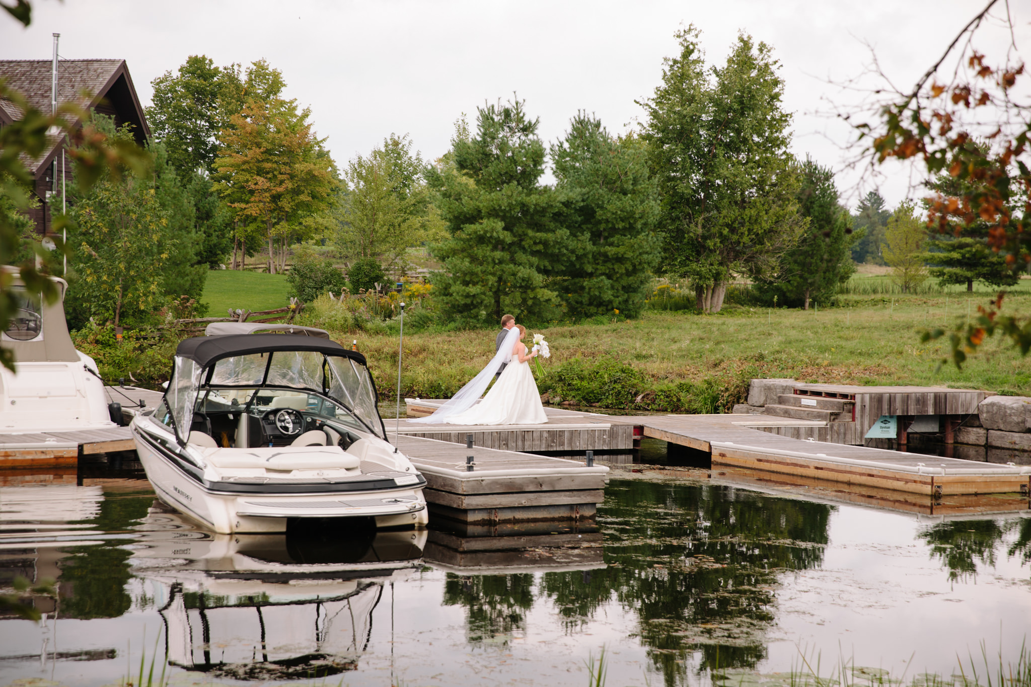 bride coming off boat down dock to enter for wedding ceremony