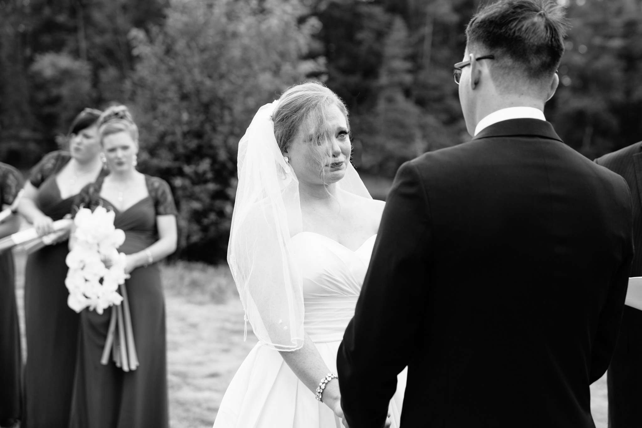 bride tearing up during vows at wedding ceremony