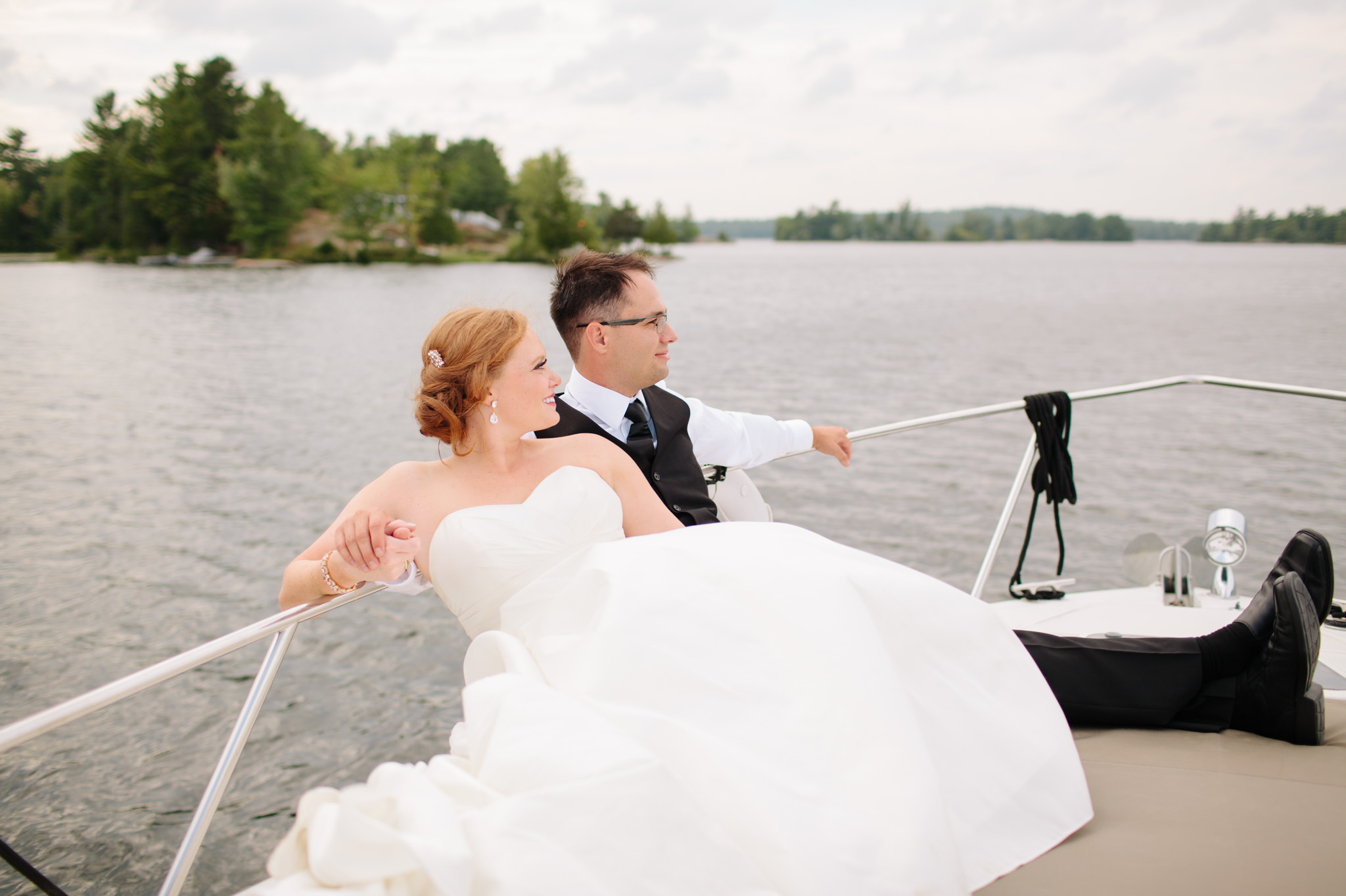 bride and groom in boat on Stony Lake in Lakefield