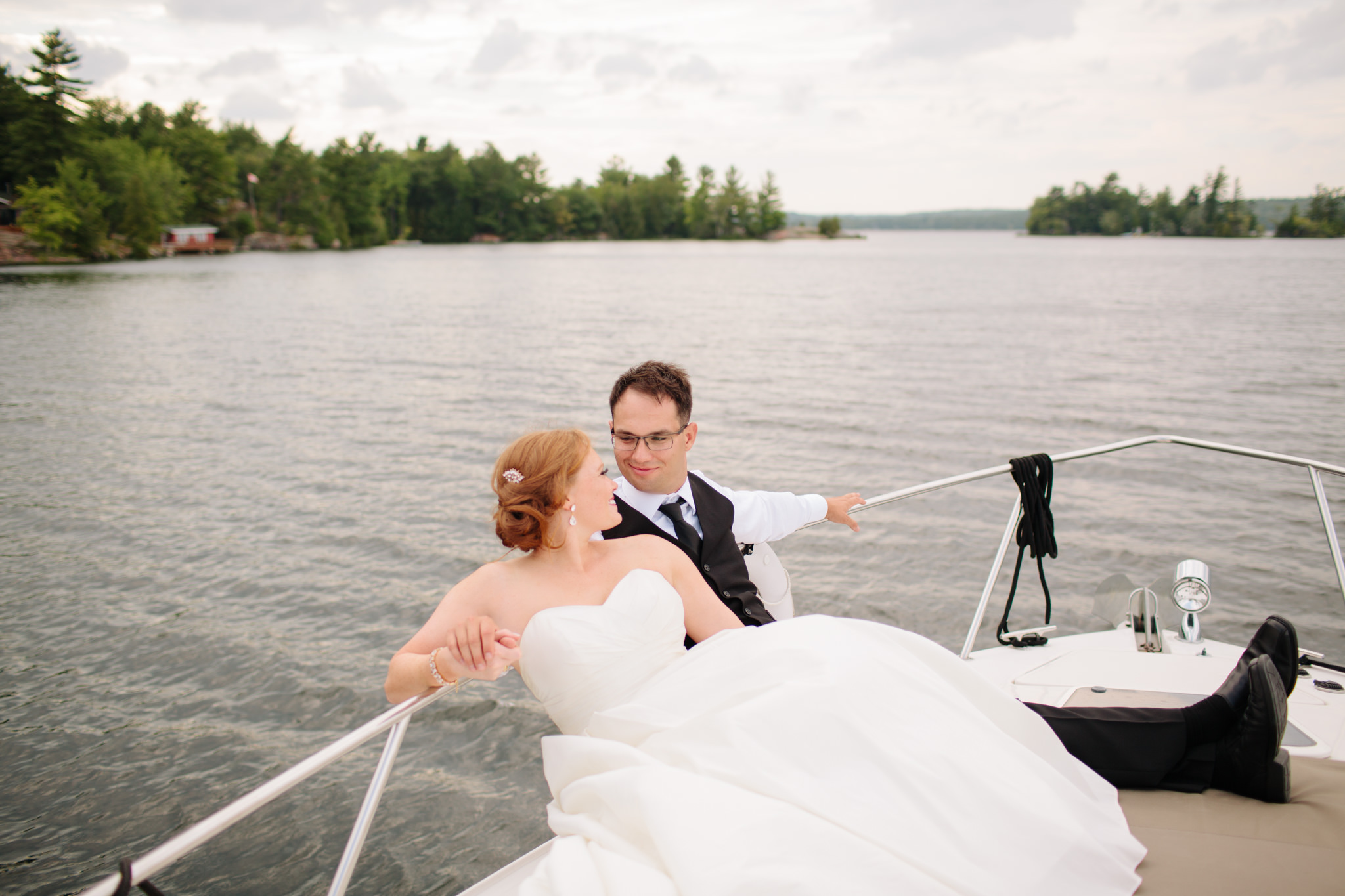 bride and groom on boat after wedding ceremony