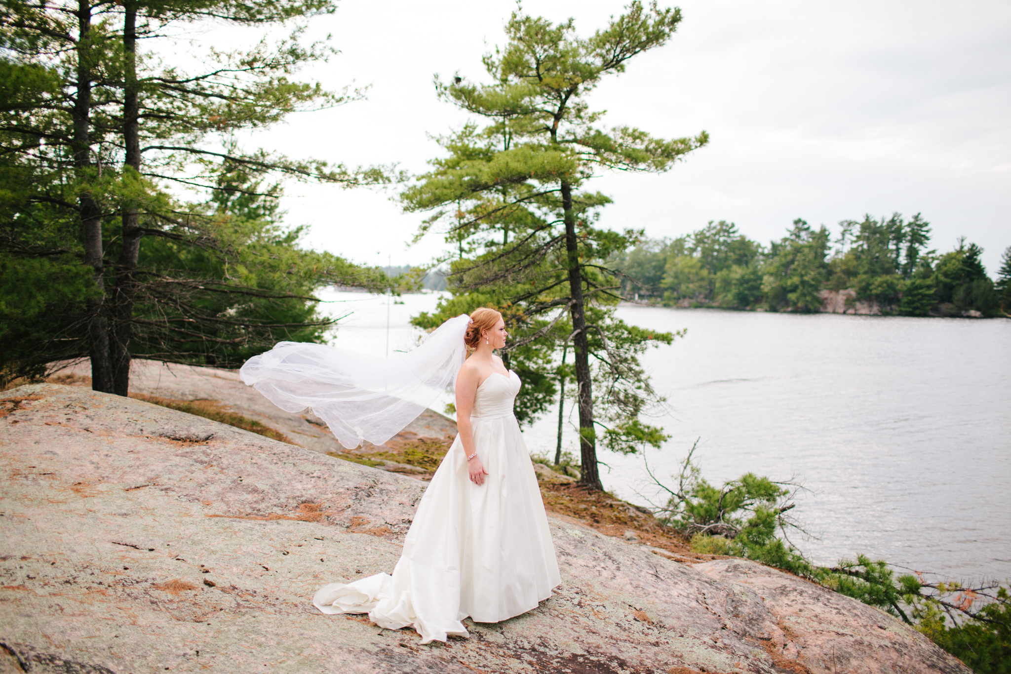 bride looking over the lake