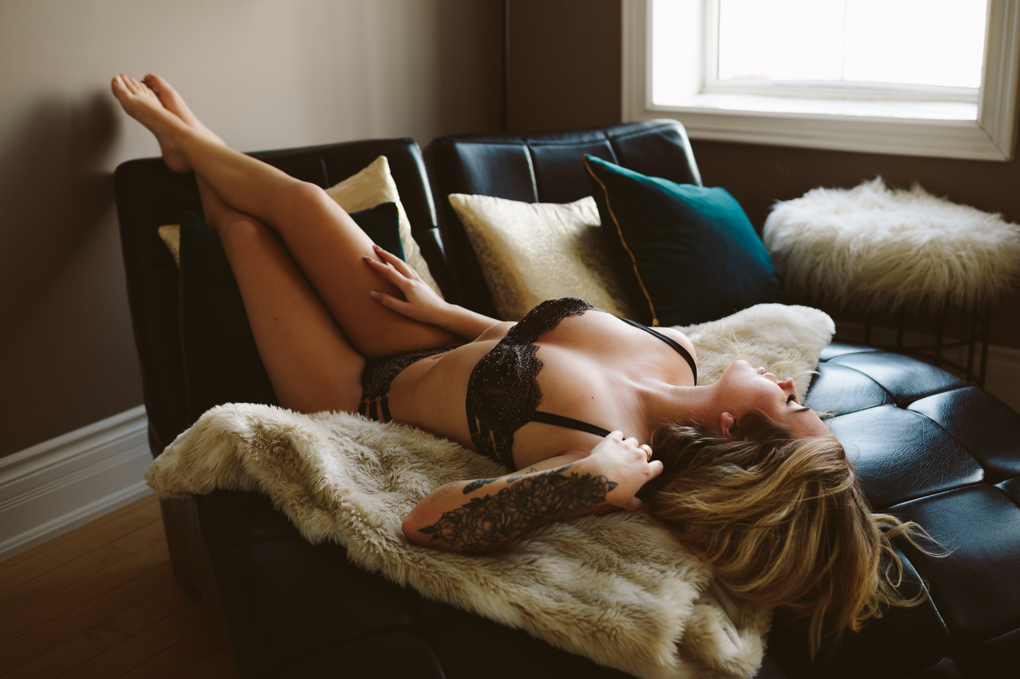 girl laying on chair