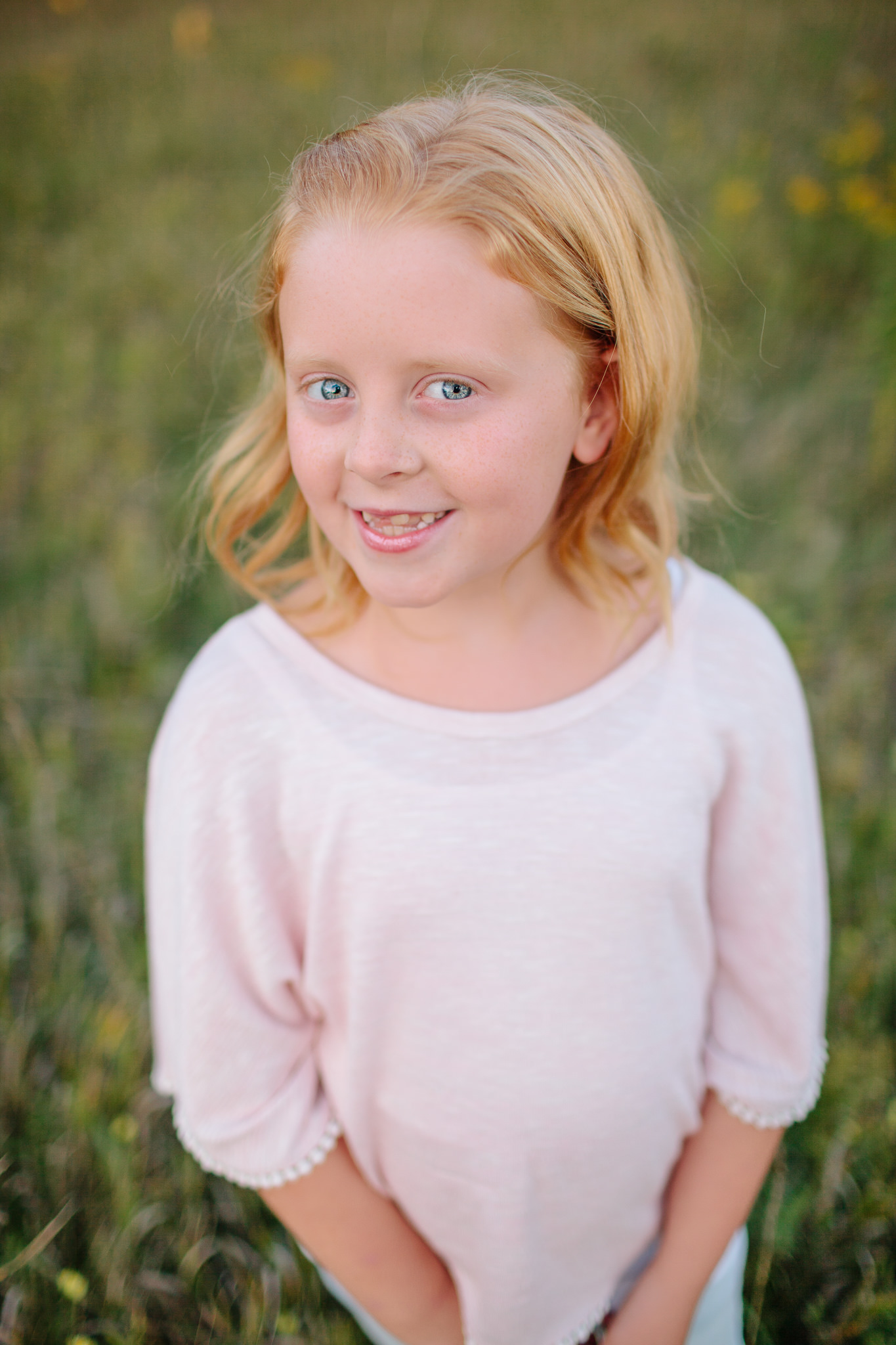 girl smiling for family portraits
