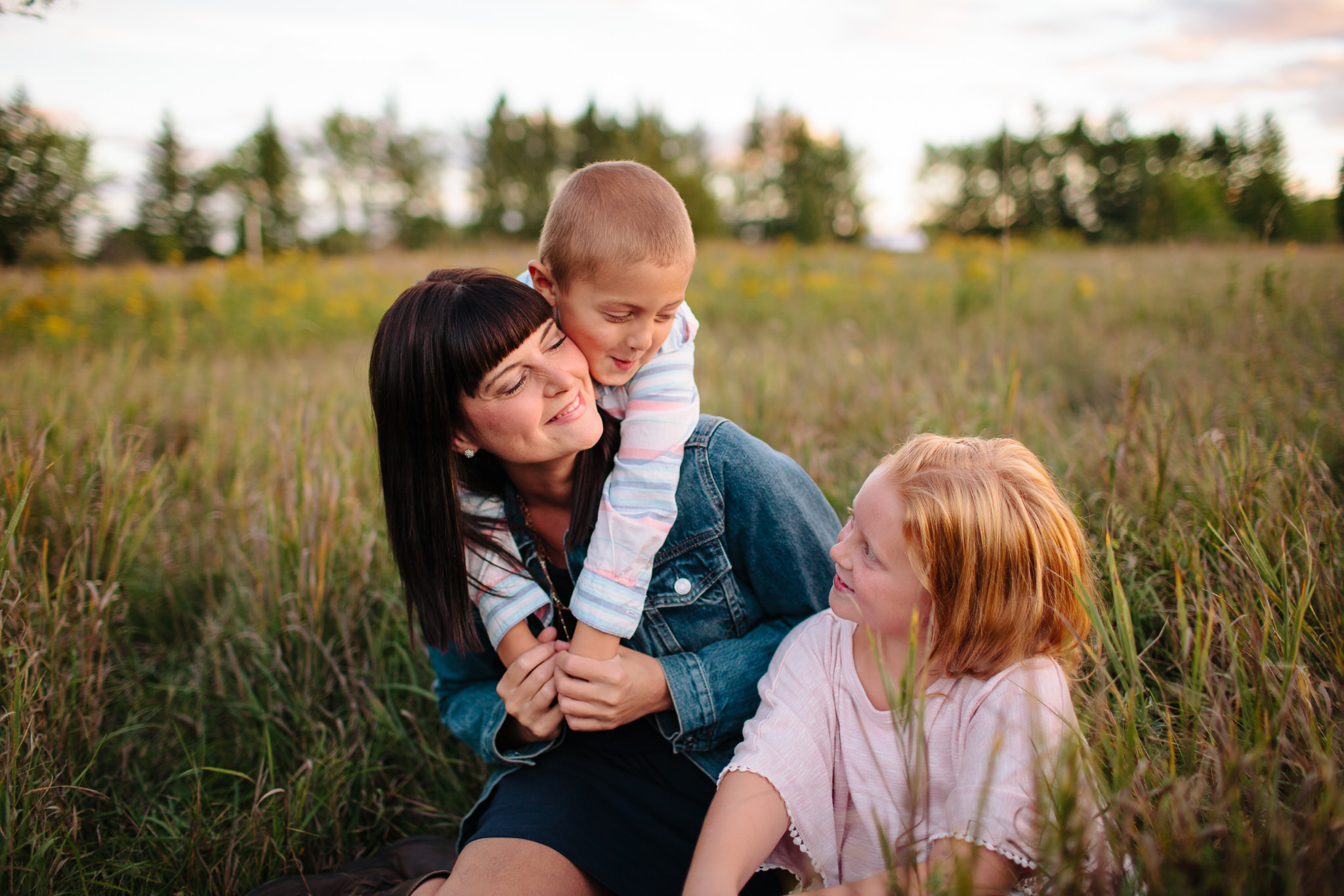 family smiling and laughing for family portrait photography