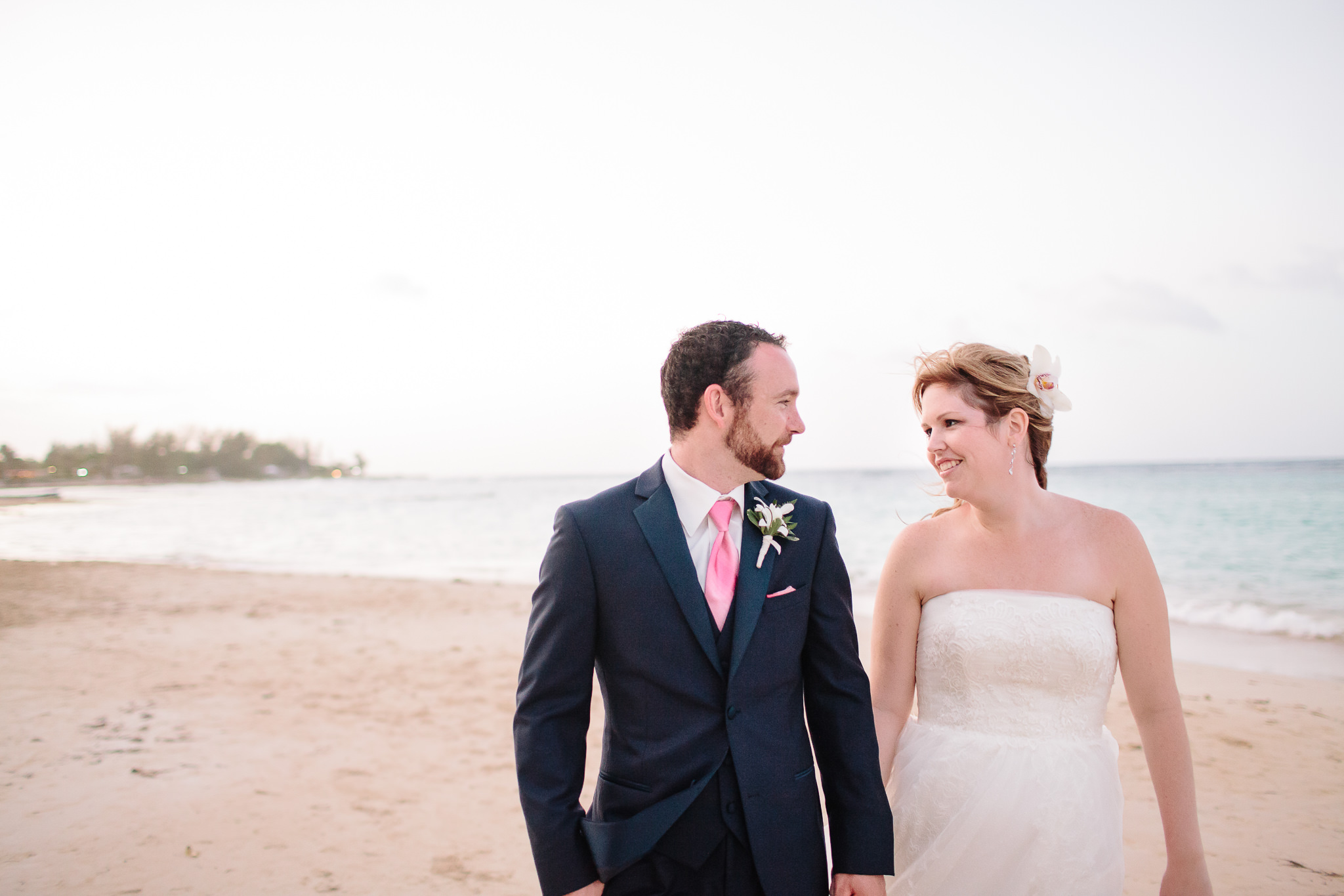 bride and groom looking at each other on beach in jamaica