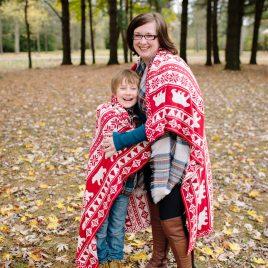 boy hugging mom for christmas photo