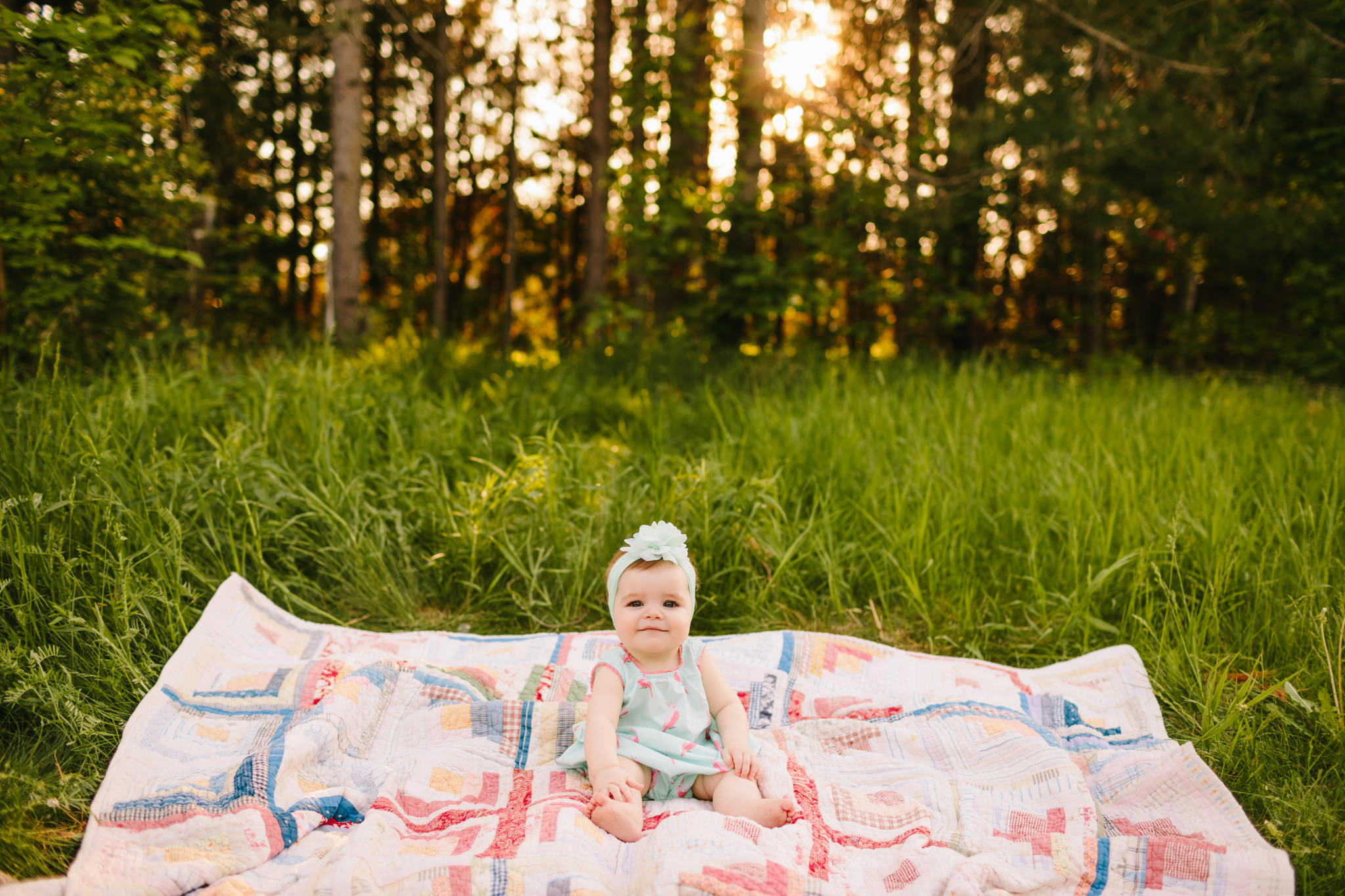 baby sitting on vintage quilt for a family photoshoot in Lindsay
