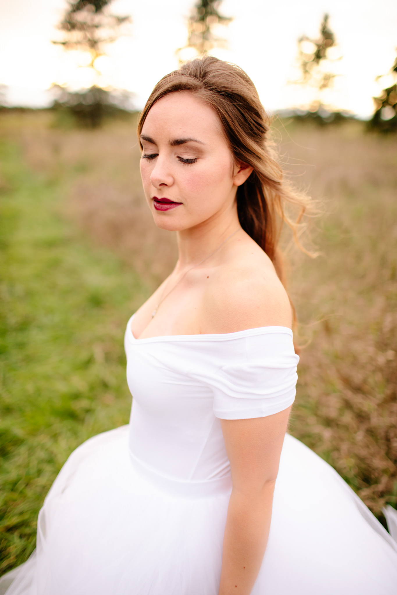 bride standing with closed eyes displaying makeup