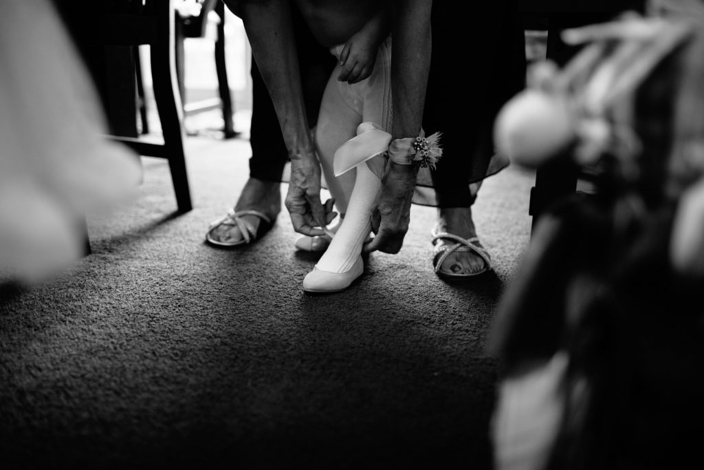 shoes and stockings going on a flower girl