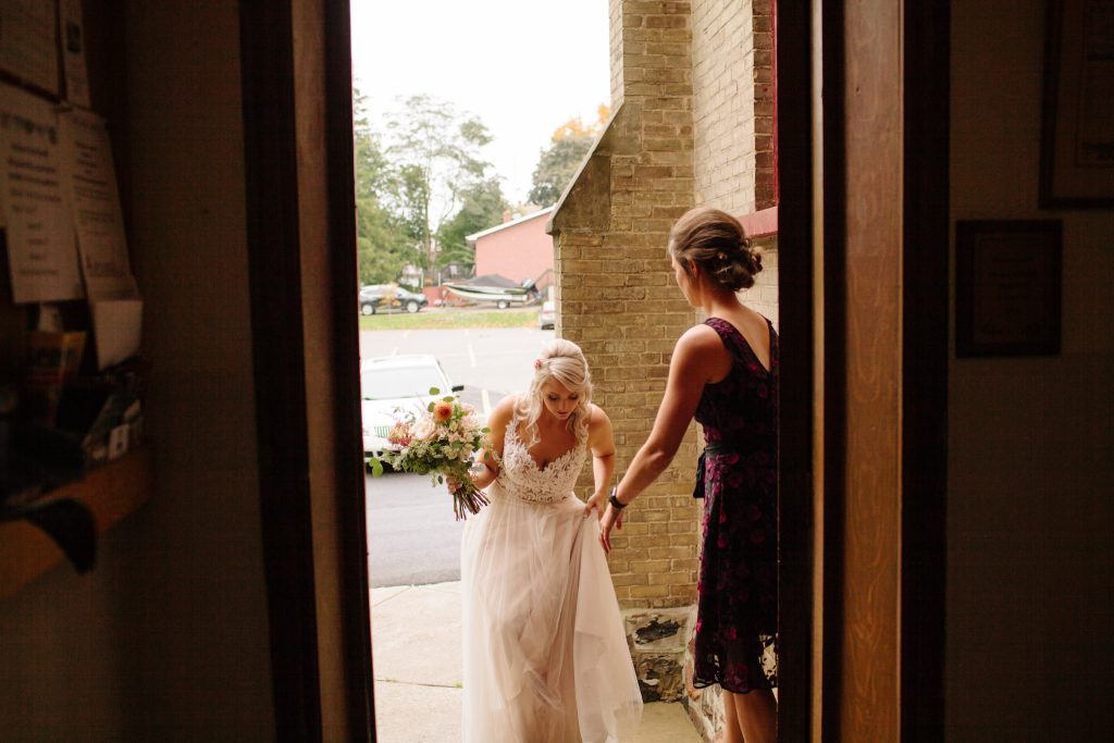 bride walking into church to get married