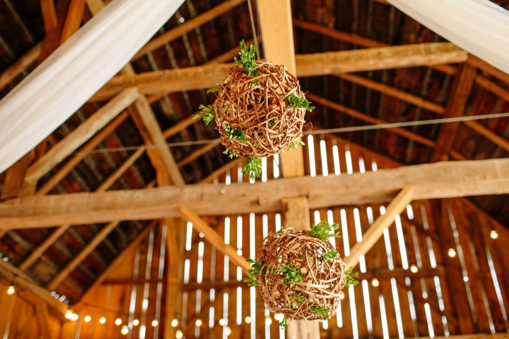 twine balls hanging in a barn for wedding celebration
