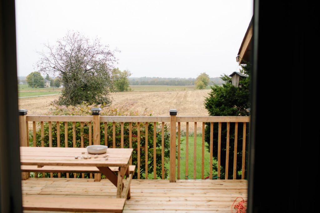 backyard landscape on an overcast day over farm hills