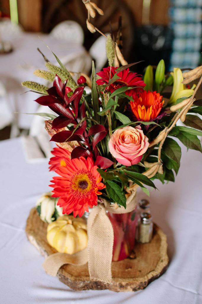 floral centerpiece in a barn wedding during the fall