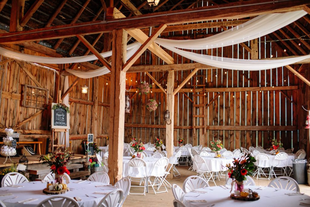 inside decoration of an outdoor barn wedding