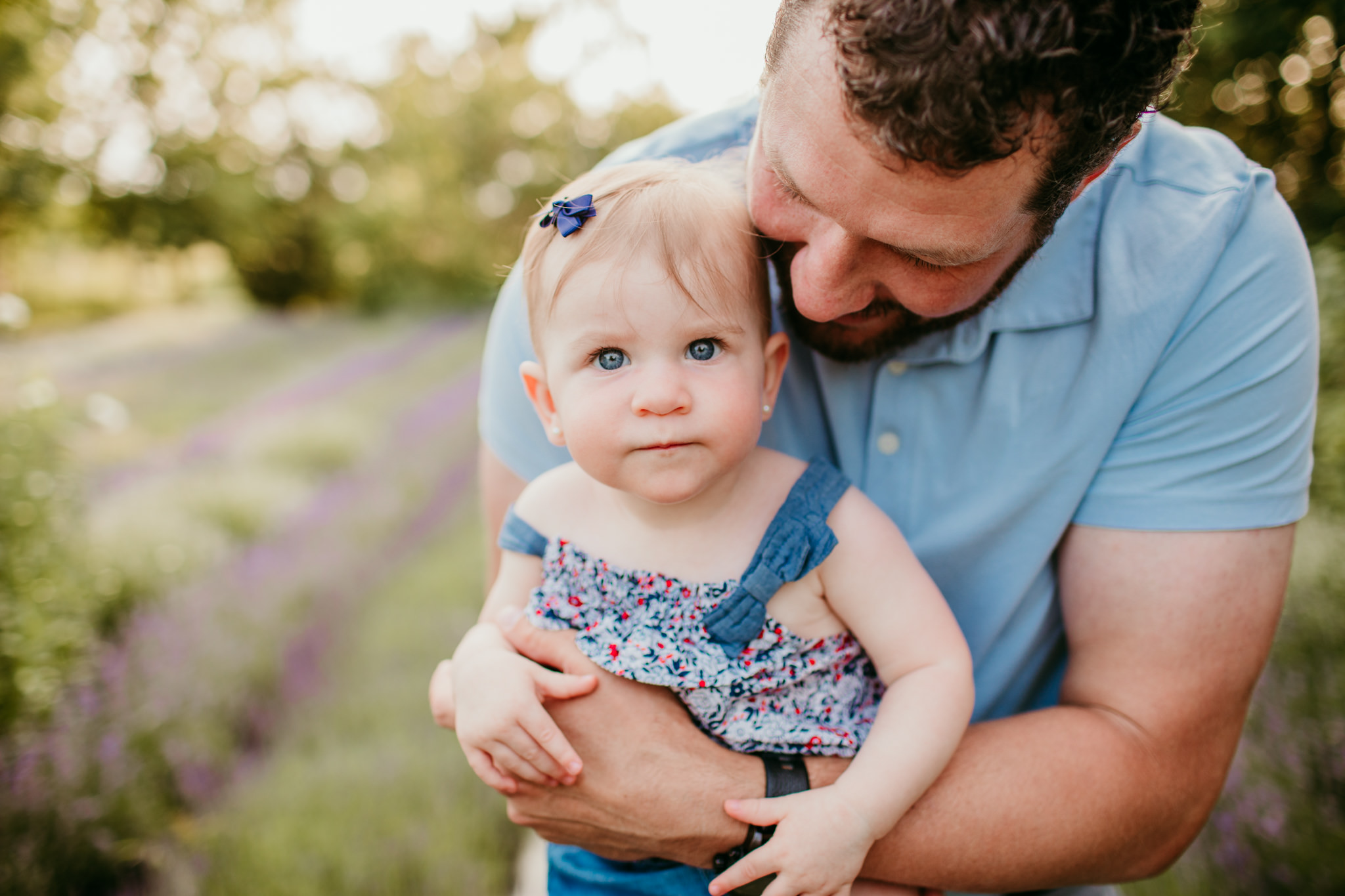 babe in arms of dad during durham area lavender session
