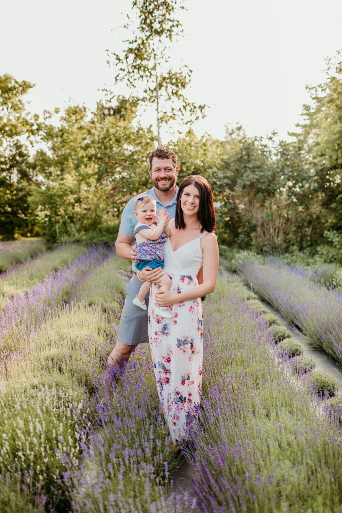 family standing in a lavender field for a family portrait photoshoot