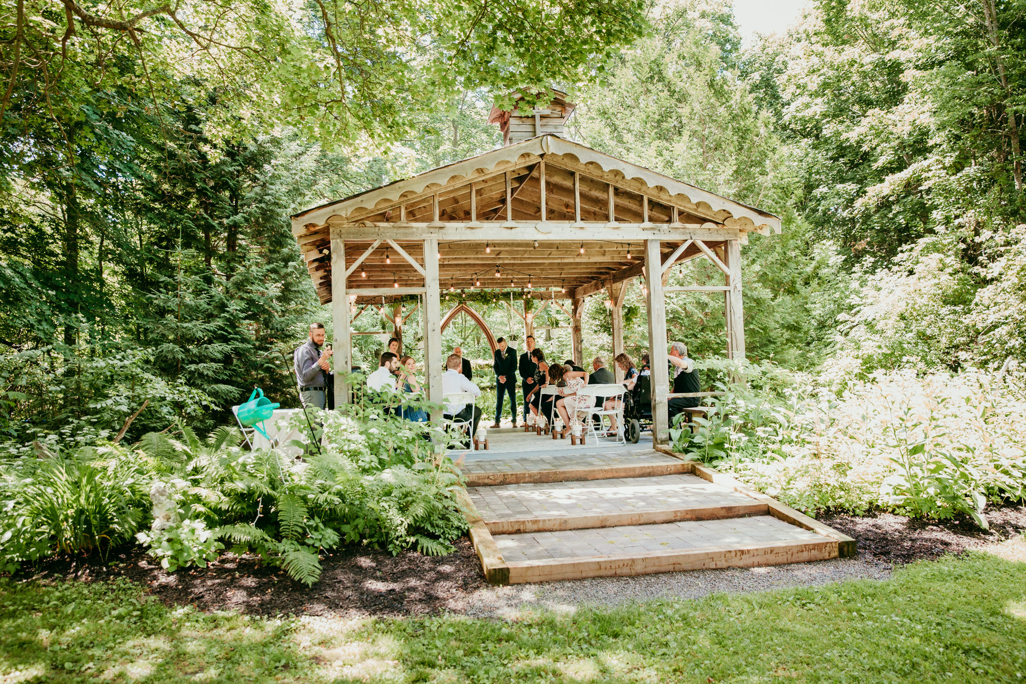 gazebo amongst the garden for a wedding ceremony
