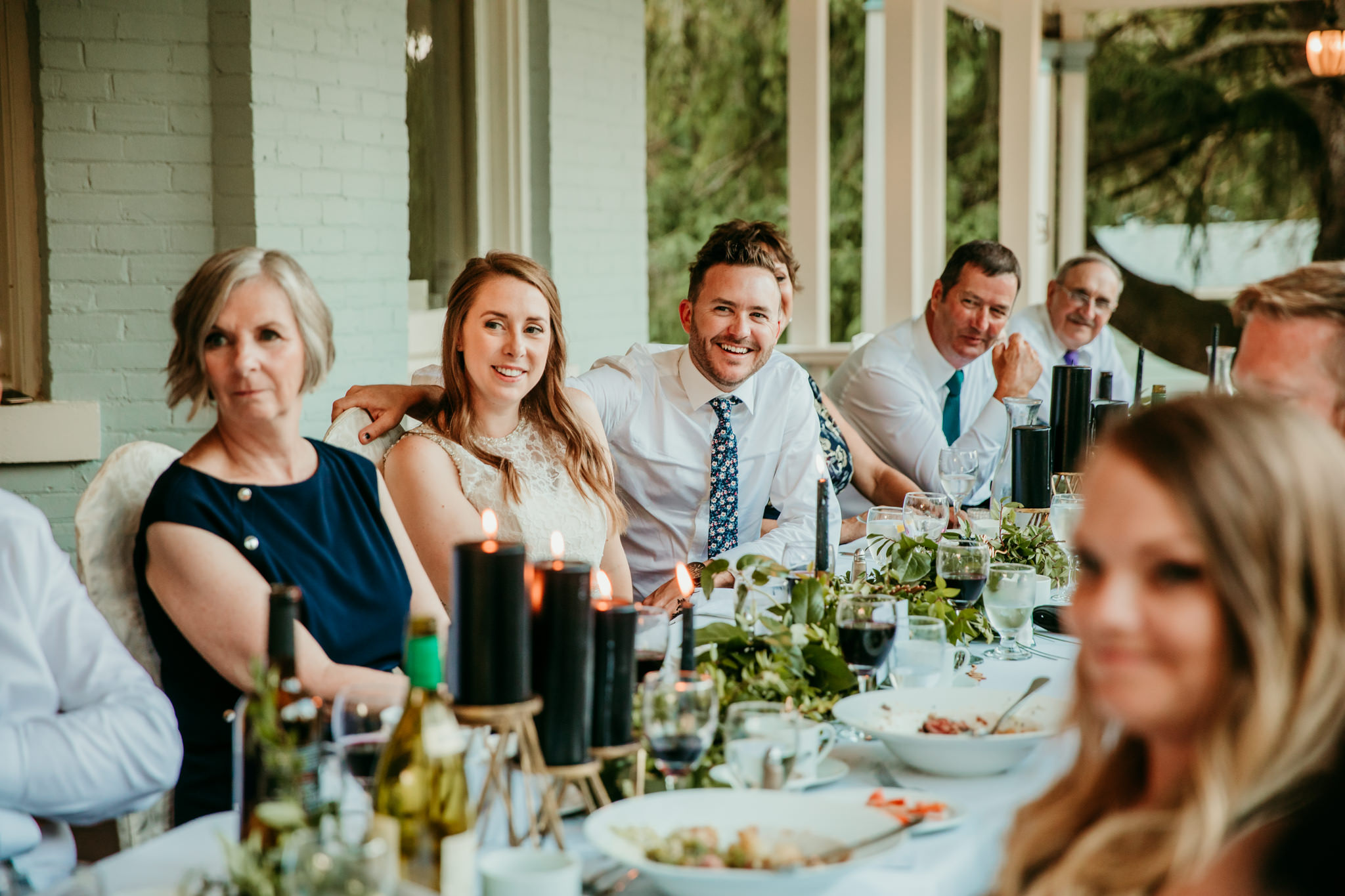 bride and groom laughing during wedding reception