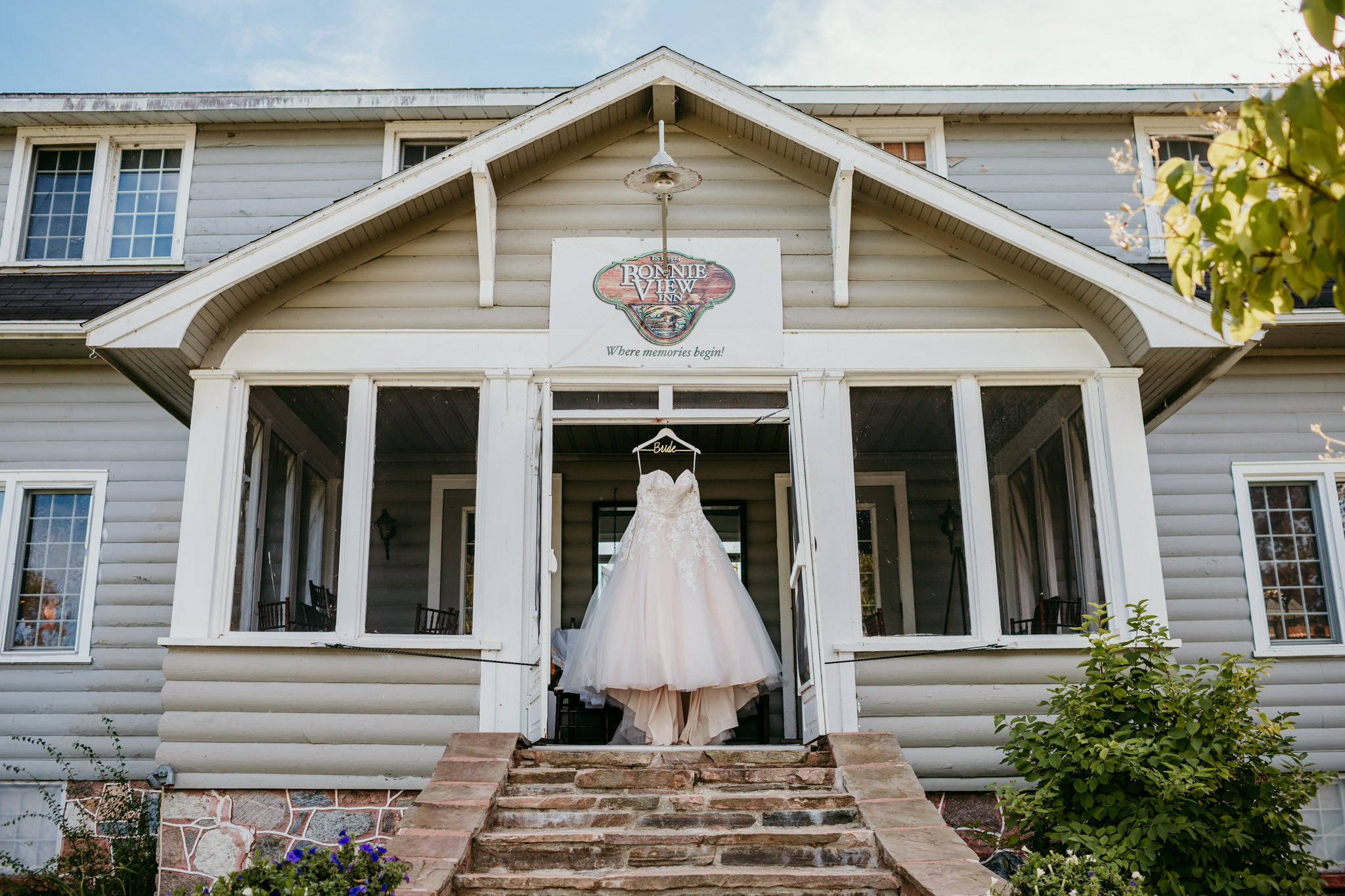 wedding dress hanging from doorway of Bonnie View Inn