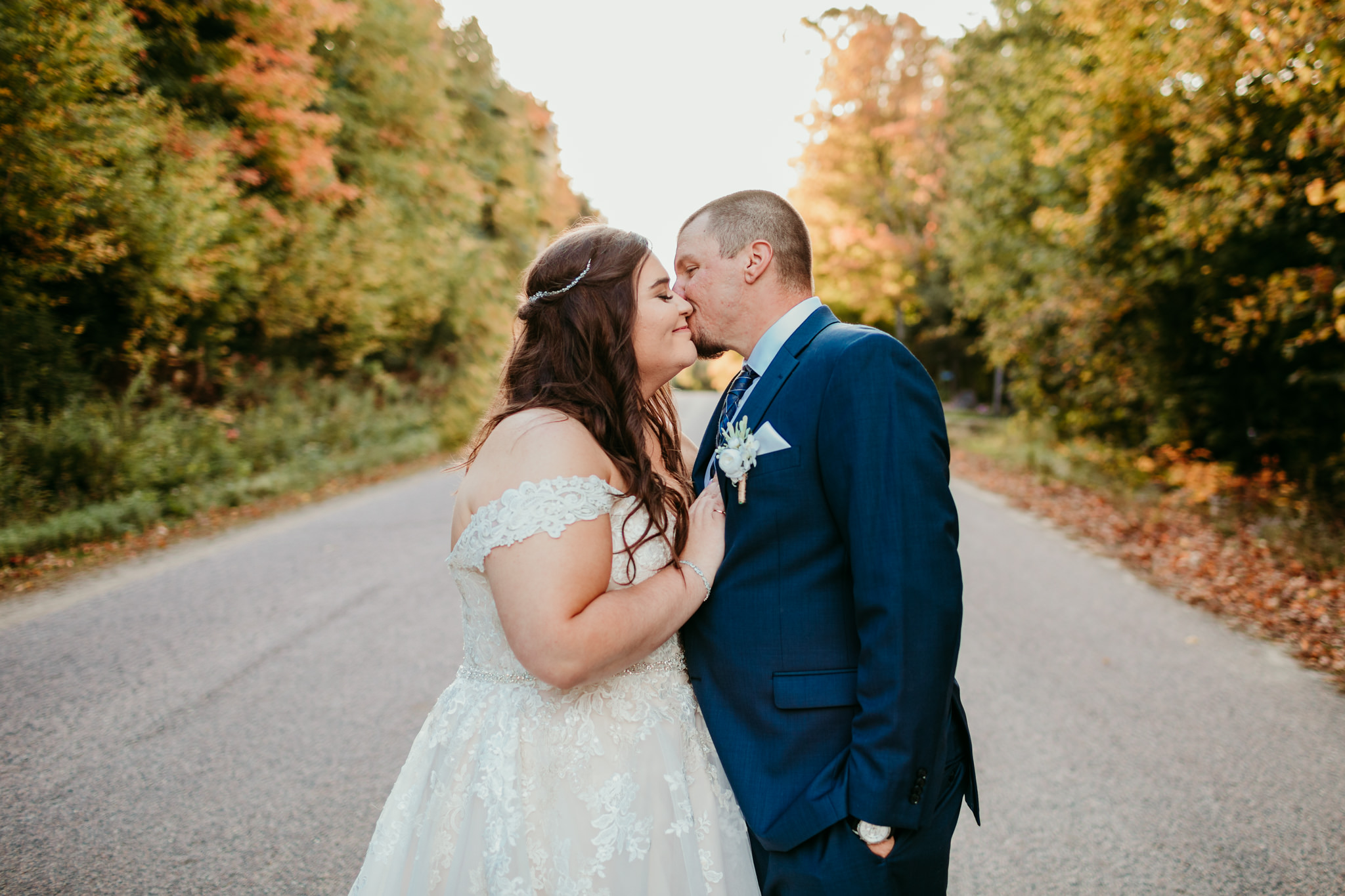 bride and groom sharing a kiss during their fall wedding in haliburton