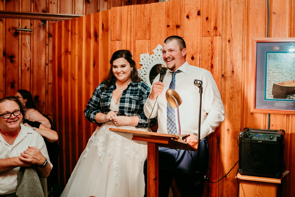 bride and groom giving speech at Bonnie View inn during fall wedding
