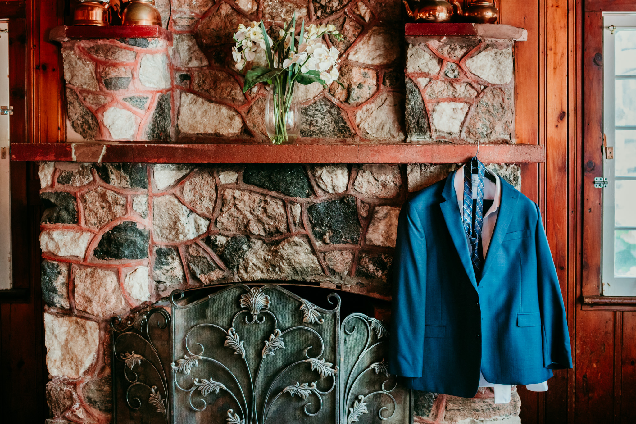 suit hanging on fireplace