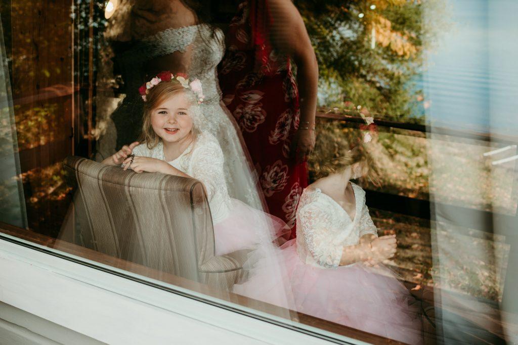 flower girls in reflection of window