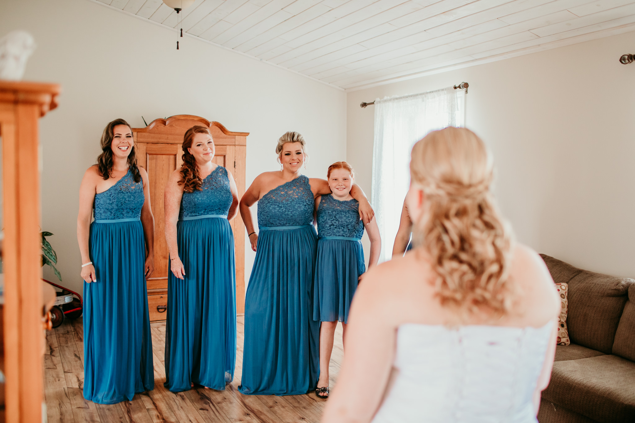 bridesmaid reaction to bride coming out with her wedding dress on for the first time