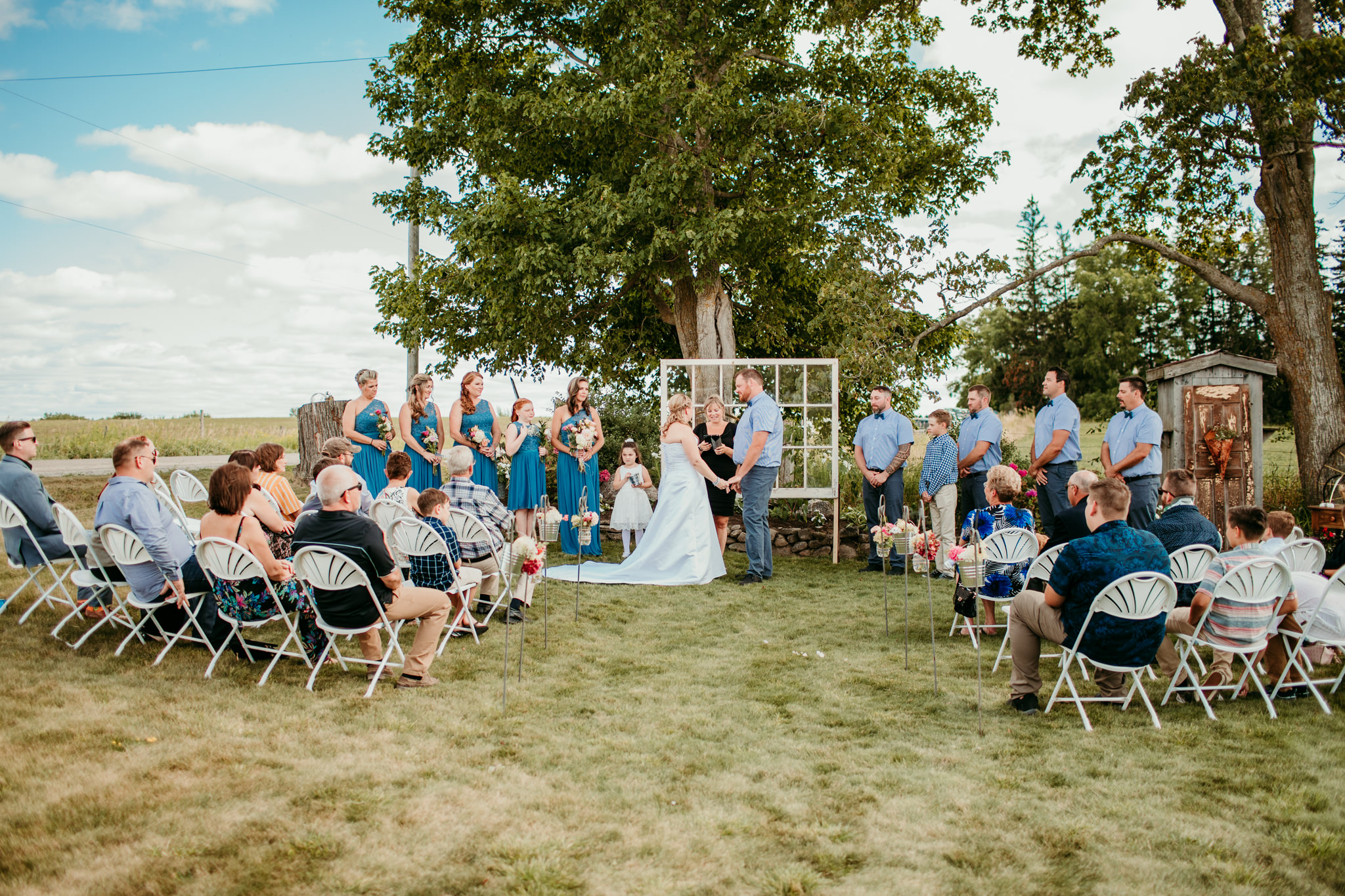 bride and groom standing at altar during their wedding Oakwood ceremony