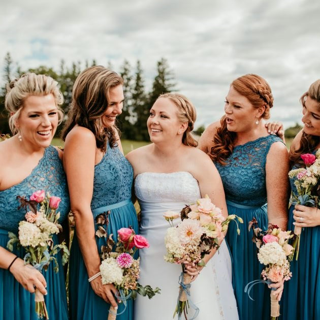 bridesmaids snuggling and laughing at each other
